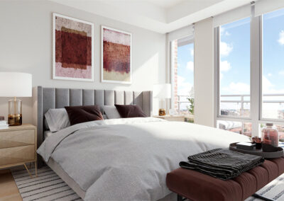 A view of one bedroom in a TRIBECA condo unit with ample space, natural light and a view to the private balcony.