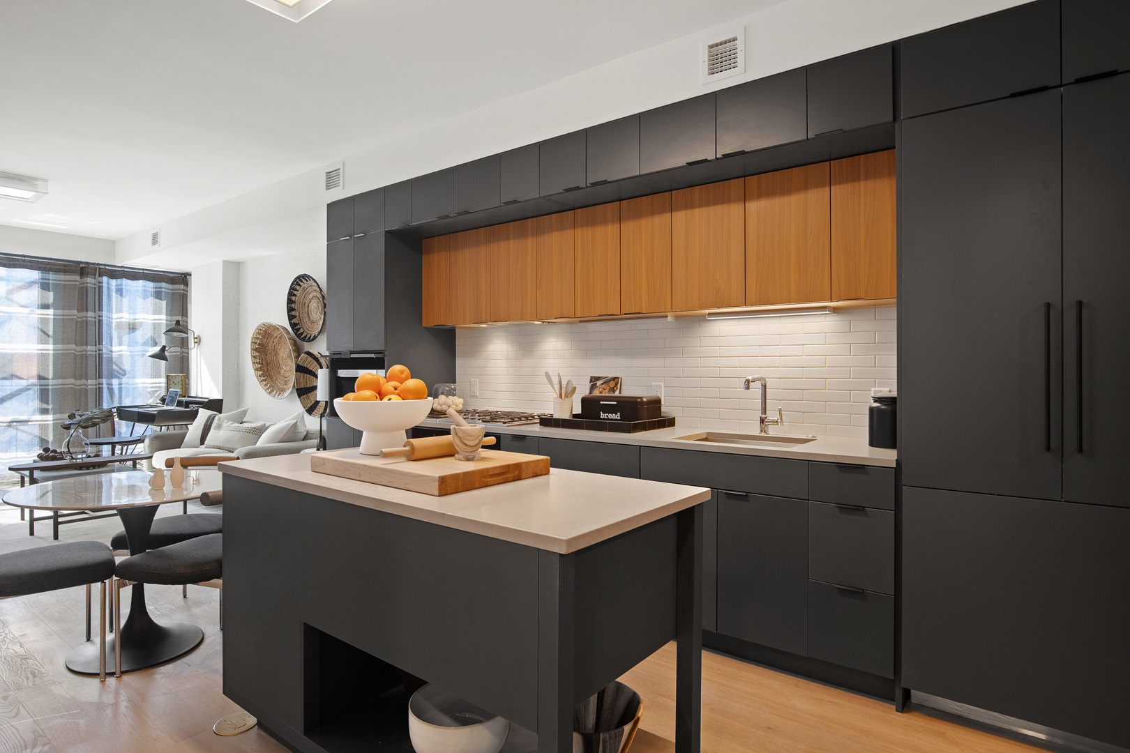 A view of the kitchen and living space in a TRIBECA condo in Washington DC.